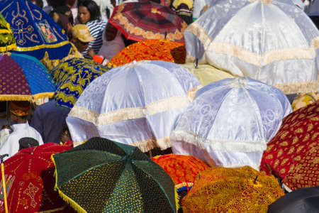 Gonder, Ethiopia - January 19, 2012: group of unidentified people under colorful umbrellas during the Timkat holiday, the important Ethiopian Orthodox celebration of Epiphany.