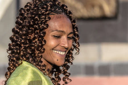 ethiopian ethnicity: Gonder, Ethiopia - January 19, 2012: Portrait of a young woman with beautiful hair in the street of Gonder during the Timkat holiday, the important Ethiopian Orthodox celebration of Epiphany. Editorial