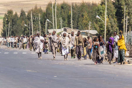 ethiopian ethnicity: Korem, Ethiopia - January 26, 2012: Group of unidentified pilgrims walking on the road to Korem, near Lalibela during the Timkat holiday, the important Ethiopian Orthodox celebration of Epiphany. Editorial