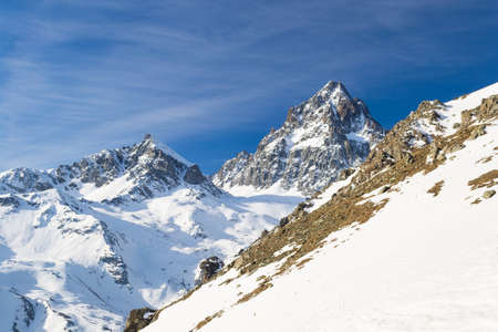 cuneo province: Stunning view of the elegant shape of M. Viso (3848 m) from the alpine arc in late winter season and beginning of spring with slowly melting snow. Cuneo Province on Italy France border.