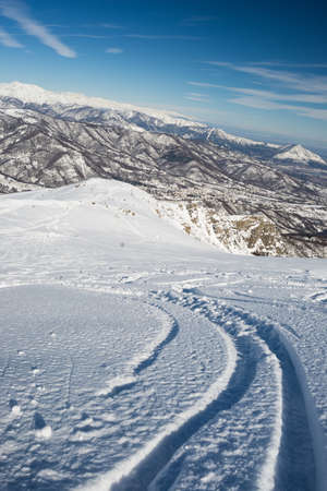 back country: Free ride ski tracks on snowy slope. Oblique shot taken from above in the italian Alps. Old ski resort now used for back country skiing.