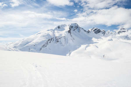Stunning view of high mountain peaks in the italian alpine arc, in a bright sunny day and lot of candid snow. Ski resort of La Thuile and La Rosiere, on the border Italy France. Stock Photo