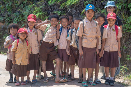 indonesia culture: Mamasa, Sulawesi, Indonesia - August 16, 2014: Group of school children of Toraja ethnicity in brown uniform smiling while looking at the camera in the countryside of Mamasa, West Tana Toraja. Editorial