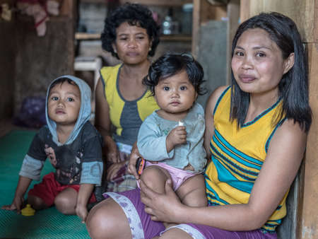 indonesia girl: Loko, Sulawesi, Indonesia - August 17, 2014: Indoor portrait of a cute family, two adult women and two babies, in the village of Loko, Mamasa region, West Tana Toraja.