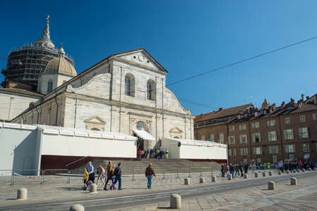 shroud: Torino, Italy - April 21, 2015: pilgrims waiting at the entrance of the Cathedral of Turin, Italy, for 2015 Holy Shroud Exhibition. Wide angle view from below.