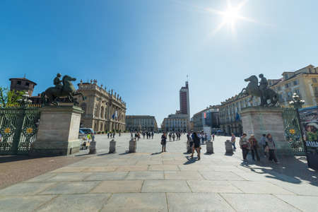 shroud: Torino, Italy - April 21, 2015: Tourists and pilgrims roaming in the historical centre of Turin, Italy, in the period of 2015 Holy Shroud Exhibition. Wide angle view in a bright sunny day.