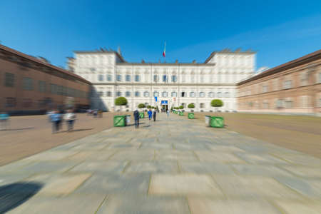 shroud: Tourists and pilgrims roaming in the historical centre of Turin, Italy, in the period of 2015 Holy Shroud Exhibition. Wide angle view in a bright sunny day with radial blur filter applied.