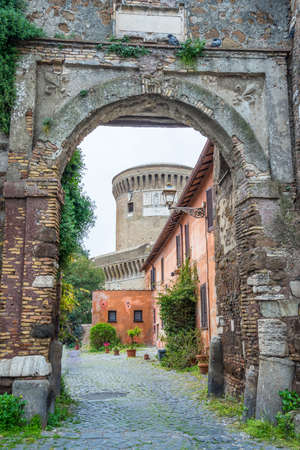 Details in the old town of Ostia, Rome, Italy. an ancient roman arch with alleys and buildings, weathered but restored, heritage of early italian history, now travel destination for tourists. photo