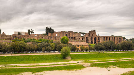 massimo: Panoramic view of Circo Massimo ruins in Rome city centre Italy, with dramatic cloudy sky in the background.