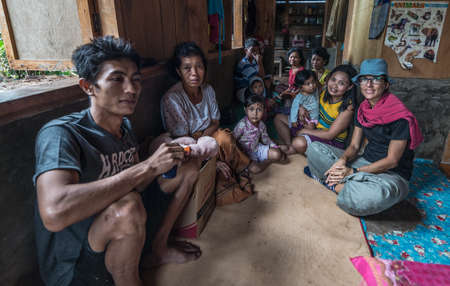 Loko, Sulawesi, Indonesia - August 17, 2014: Indoor portrait of a huge family, in their own home in the village of Loko, Mamasa region, West Tana Toraja, South Sulawesi, Indonesia.