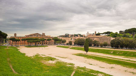 massimo: Panoramic view of Rome city centre from Circo Massimo with Vittoriano white building at the horizon and dramatic cloudy sky in background, Italy. Stock Photo