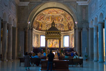 vincoli: Rome, Italy - April 27, 2015: Tourist and devotees walking inside the beautiful San Pietro in Vincoli church in Rome city centre, Italy. Saint Peter in Chains is the english translation.