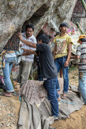 primitivism: Lokomata, Indonesia - September 9, 2014: the ceremony of cleaning corpses, held once in every 5 or 10 years in Tana Toraja, South Sulawesi.