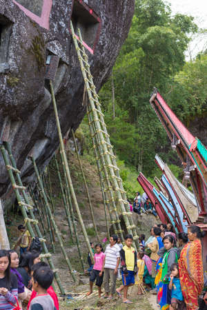 9 10 years: Lokomata, Indonesia - September 9, 2014: the ceremony of cleaning corpses, held once in every 5 or 10 years in Tana Toraja, South Sulawesi.