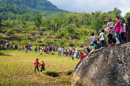 corpses: Lokomata, Indonesia - September 9, 2014: Group of people on rice field attending the ceremony of cleaning corpses in Lokomata, Tana Toraja, Sulawesi, Indonesia. Editorial