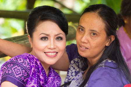 south asian ethnicity: Sangalla, Indonesia - September 8, 2014: Portrait of two smiling young women of Toraja ethnicity in traditional attire, in Sangalla, Sulawesi, Indonesia.