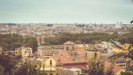 personal perspective: Personal perspective of Rome, Italy, at dusk. Panoramic cityscape from above with old retro filter applied. Toned, decontrasted and desaturated image, vignetting added. Stock Photo