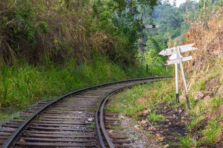railroad track: Old and obsolete railroad track still used in the hill region of Sri Lanka, connecting Colombo to Kandy, Nuwara Elyia, Haputale, Badulla and still used for tourism, communting and cargo purpose. Concept of traveling mode in Asian countries.