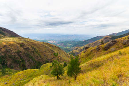 Wide angle view of the Hill Country in Sri Lanka, near Hortons Plain and the Worlds End, famous travel destination and tourist spot for adventure people. Stock Photo
