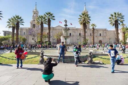 plaza de armas: Arequipa, Peru - August 15, 2015: People and tourists taking photos of Plaza de Armas and the Cathedral in Arequipa, famous travel destination and landmark in Peru.