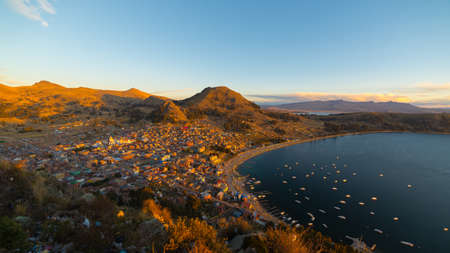 summit lake: Panoramic view of Copacabana Bay on Titicaca Lake from the summit of Mount Calvario (3966 m), among the most important travel destination in Bolivia. Stock Photo