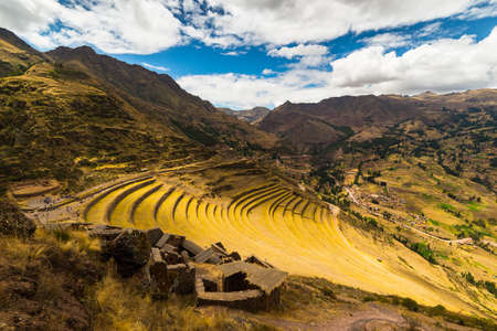 pisac: Wide angle view of the glowing majestic concentric terraces of Pisac, Incas site in Sacred Valley, major travel destination in Cusco region, Peru.