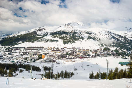 Panoramic view of Sestriere village from above, famous ski resort in the italian western Alps, Piedmont, Italy.