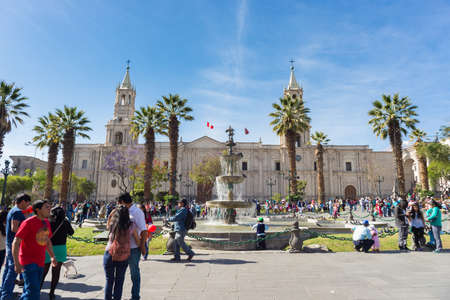 plaza de armas: Arequipa, Peru - August 15, 2015: People and tourists roaming in Plaza de Armas and in front of the Cathedral in Arequipa, famous travel destination and landmark in Peru.