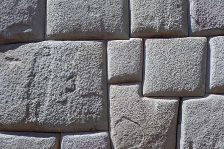 volcanic stones: Inca wall made of natural volcanic stones, perfectly shaped, heritage of Inca history and architecture in Cusco, Peru. Background, pattern and texture, light gray color. Stock Photo
