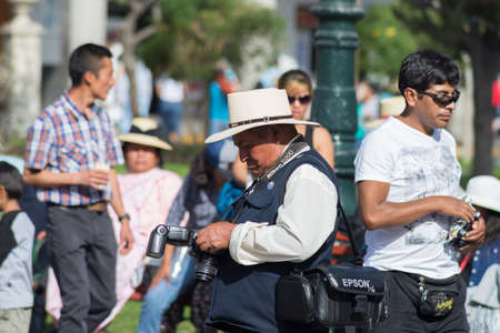plaza de armas: Arequipa, Peru - August 15, 2015: Professional street photographer at work in Plaza de Armas, Arequipa, Peru. Concept of obsolete jobs in developing countries.