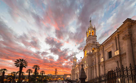 stunning: Stunning colorful sky at dusk in Arequipa, famous travel destination and landmark in Peru. Wide angle view from below of the colonial Cathedral.