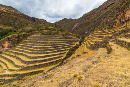 cusco region: Wide angle view of the glowing majestic concentric terraces of Pisac, Incas site in Sacred Valley, major travel destination in Cusco region, Peru.