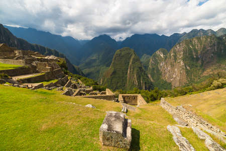urubamba valley: Wide angle panoramic view from Machu Picchu, illuminated by afternoon sunlight, over the majestic Urubamba Valley with dramatic sky.