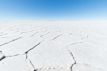 salt flat: Wide angle view of the world famous Uyuni Salt Flat, among the most important travel destination in the Bolivian Andes. Close up of hexagonal shapes of the salt pans. Stock Photo