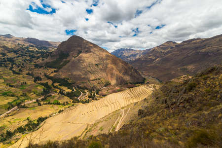 sacred valley of the incas: Wide angle view of the glowing majestic concentric terraces of Pisac, Incas site in Sacred Valley, major travel destination in Cusco region, Peru.