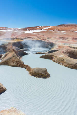 hot water geothermal: Steaming hot water ponds and mud pots in geothermal region of the Andean Highlands of Bolivia. Roadtrip to the famous Uyuni Salt Flat. Stock Photo