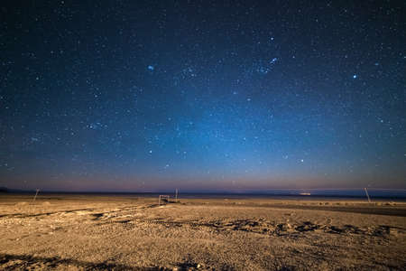 Outstanding starry sky at high altitude on the barren highlands of the Andes in Bolivia. Football ground (soccer field) in the middle of nowhere. Winter season. 스톡 콘텐츠