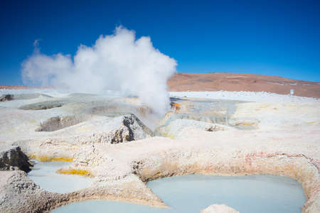 highlands region: Steaming hot water ponds and mud pots in geothermal region of the Andean Highlands of Bolivia. Roadtrip to the famous Uyuni Salt Flat. Stock Photo