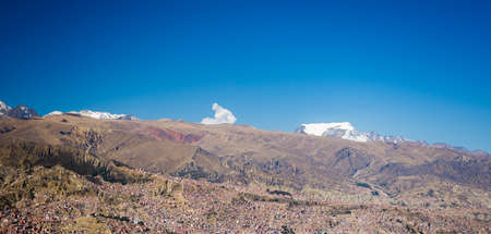 la paz: Cityscape of La Paz from El Alto, Bolivia, with the stunning snowcapped mountain range in the background.