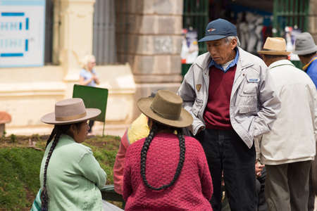 peruvian ethnicity: Cusco, Peru - September 9, 2015: People of peruvian ethnicity talking in the streets of Cusco, former Inca capital, famous travel destination in Peru and one of the most visited historical cities in the world.