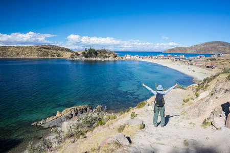 outstretched arms: Woman with outstretched arms on Incas trail at the Island of the Sun, Titicaca Lake, Bolivia. Concepts of people traveling around the world.