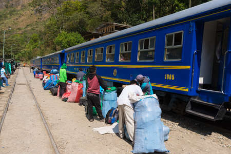 urubamba valley: Hydroelectric Station, Peru - September 8, 2015: Food stalls, peruvian people and tourists at Hydroelectric Station, Peru, on the railroad track connecting Machu Picchu village, mostly used for tourism and cargo purpose.
