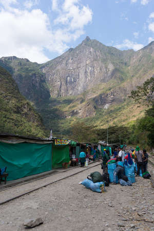 hydroelectric station: Hydroelectric Station, Peru - September 8, 2015: Food stalls, peruvian people and tourists at Hydroelectric Station, Peru, on the railroad track connecting Machu Picchu village, mostly used for tourism and cargo purpose.