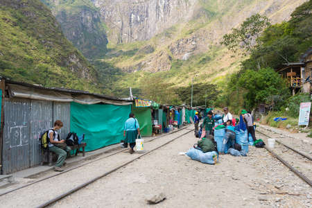adventure travel: Hydroelectric Station, Peru - September 8, 2015: Food stalls, peruvian people and tourists at Hydroelectric Station, Peru, on the railroad track connecting Machu Picchu village, mostly used for tourism and cargo purpose.