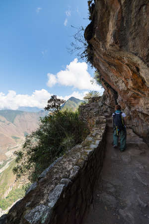boardwalk trail: Backpacker exploring the steep and dramatic Inca Trail of Machu Picchu, the most visited travel destination in Peru. Summer adventures in South America.