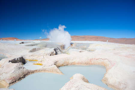 salt flat: Steaming hot water ponds and mud pots in geothermal region of the Andean Highlands of Bolivia. Roadtrip to the famous Uyuni Salt Flat. Stock Photo