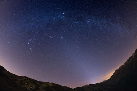 soul searching: The starry sky and Milky Way captured on the Alps by fisheye lens with scenic distortion and 180 degree view. Andromeda, The Pleiades, Orion and Sirio clearly visible. Low digital noise.