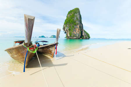 railey: Tourist boats floating on the stunning tropical sea at scenic Railey Bay, Krabi, Southern Thailand. Stock Photo