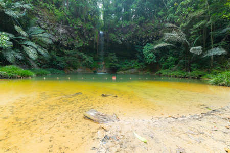 wide  wet: Dreamy multicolored natural pool hidden in the dense and umid rainforest of Lambir Hills National Park, Borneo, Malaysia. Stock Photo