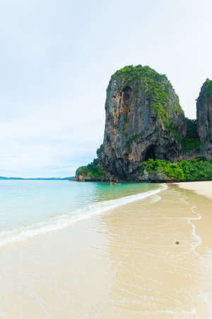 railey: Expansive view of the awesome greenish turquoise waving Andaman Sea and the scenic golden beach of Railey Bay, Krabi, Southern Thailand, during summer and monsoon season.